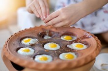 Child Hand Hammering Quail Eggs Into The Pan. Quail Egg Mortar, Thai Food