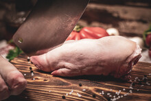 Preparing Pig Trotters To Cook On Wooden Board With Vegetables