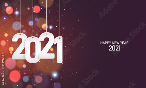 Fototapeta Happy new year 2021. Hanging white paper number with confetti on a colorful blurry background. obraz