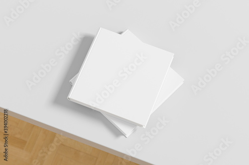 Tablou Canvas Square white hardcover book stack mockup on the white table.