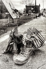 American Flags In Abandoned Boots On Road