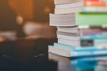 Close-up Of Books Stacked On Table