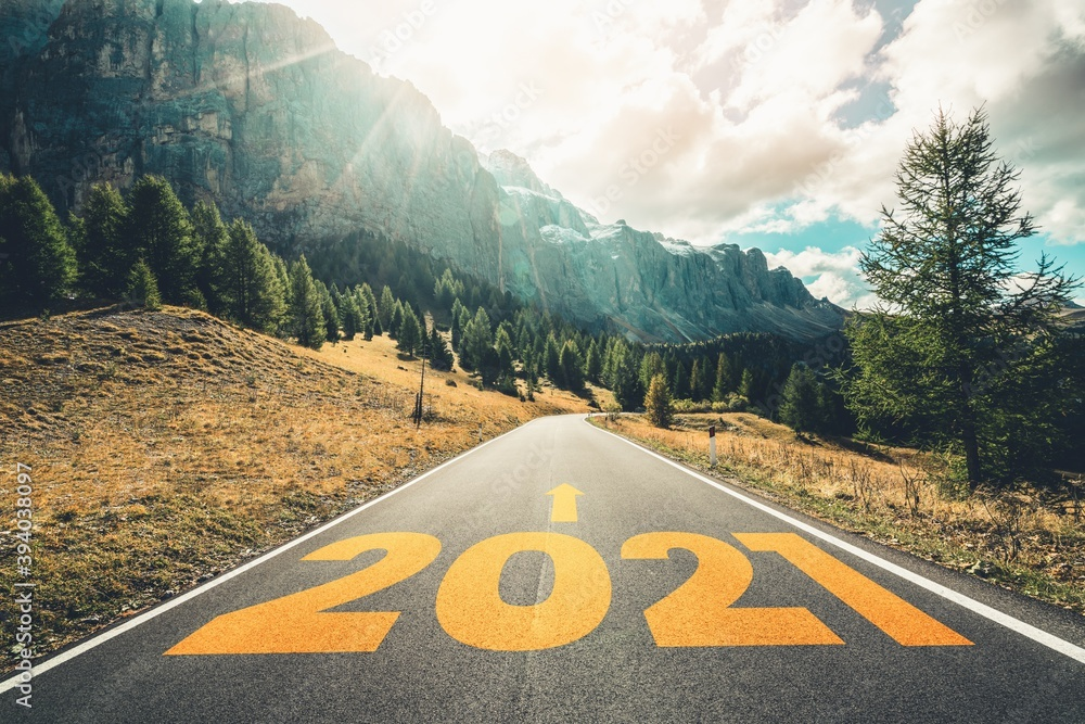 Fototapeta 2021 New Year road trip travel and future vision concept . Nature landscape with highway road leading forward to happy new year celebration in the beginning of 2021 for fresh and successful start .