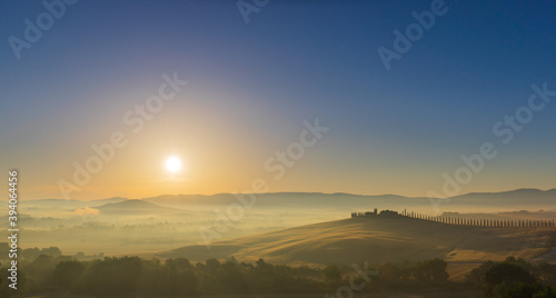 Fototapeta premium The rolling hills and green fields at sunrise, Tuscany, Italy