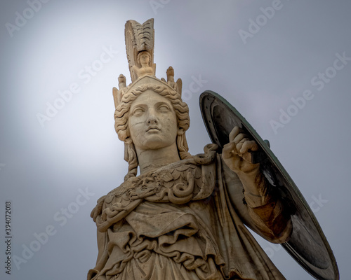 Fotomural Athena the ancient Greek goddess of knowledge and wisdom under dark cloudy sky,