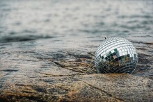 Close-up Of Disco Ball On Beach