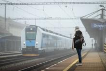 Woman Traveler Standing On Rai...