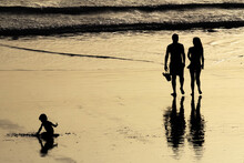 Silhouettes On The Beach At Su...