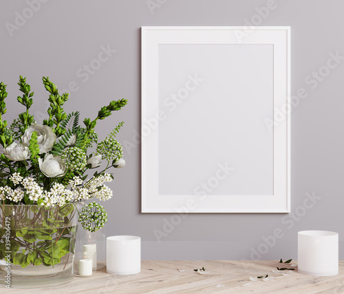 Fototapeta Mockup poster frame close up on light gray wall with white flowers and candles. 3D render obraz na płótnie