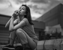 A Dramatic Black And White Portrait Of A Beautiful Girl With A Background Of A Large Building