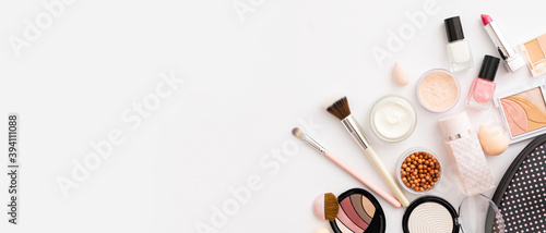 Obraz Beauty background with facial cosmetic products. Makeup, skin care concept. - fototapety do salonu