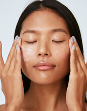 Woman Applying Face Lotion - Natural Skincare