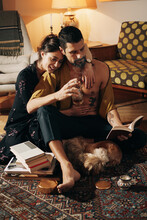 Attractive Young Couple Enjoying Leisure Time Together At Home