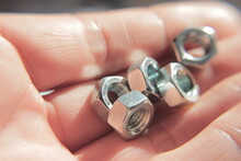 Close-up Of Bolts In A Hand