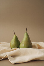 Pears On The Table With Beige Cloth