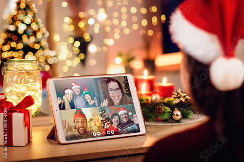 Young woman having a Christmas video call with her happy family Canvas
