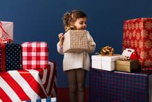 Happy Little Girl Taking Her Christmas Present