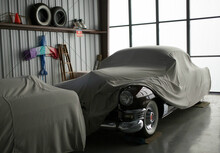 Classic Cars Covered In A Garage