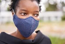 African Woman With A Face Mask