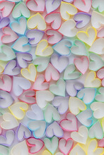 Multicolored Paper Strips In The Shape Of Hearts On White Background