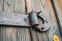 Rusty Door Hinge With Torn Off...