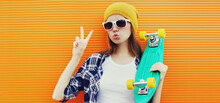 Portrait Of Girl With Skateboa...