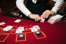 Croupier Hands Dealing Cards On T Blackjack Poker Table, Gambling Table With Cards And Chips