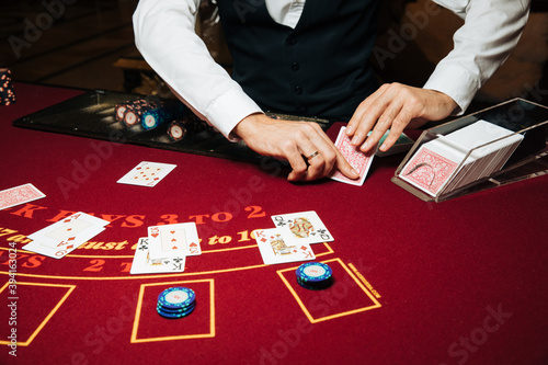 Croupier hands dealing cards on t blackjack poker table, gambling table with car Canvas Print