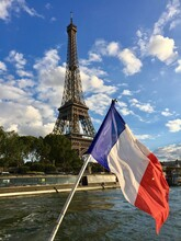 French Flag By Eiffel Tower Over River