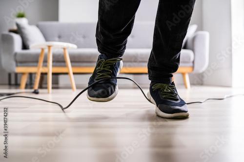Fotografía Stumble Over Cable. Clumsy Office Falldown