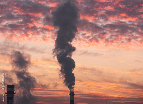 Fotografiet factory chimney at sunrise sky