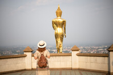 Woman Tourist Is Sightseeing At Wat Phrathat Khao Noi In Nan Province In Thailand.