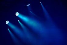 Low Angle View Of Blue Illuminated Lighting Equipment