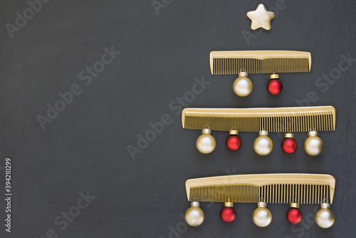 Fotografie, Obraz Christmas tree made of gold combs on a dark gray background