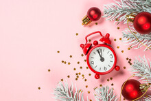 Christmas Flat Lay Background With Red Clock And Decor On Pink.