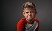 Drama Boy Showing With His Face I Dont Like You To His Parents Isolated On Grey Background. Fake Child Emotions. Human Emotions, Facial Expression Concept. Facial Expressions, Emotions, Feelings.