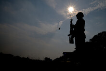 Low Angle View Silhouette Army Soldier Standing Against Sky During Sunset