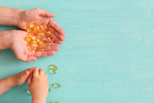 Omega 3 Capsules In The Hands ...