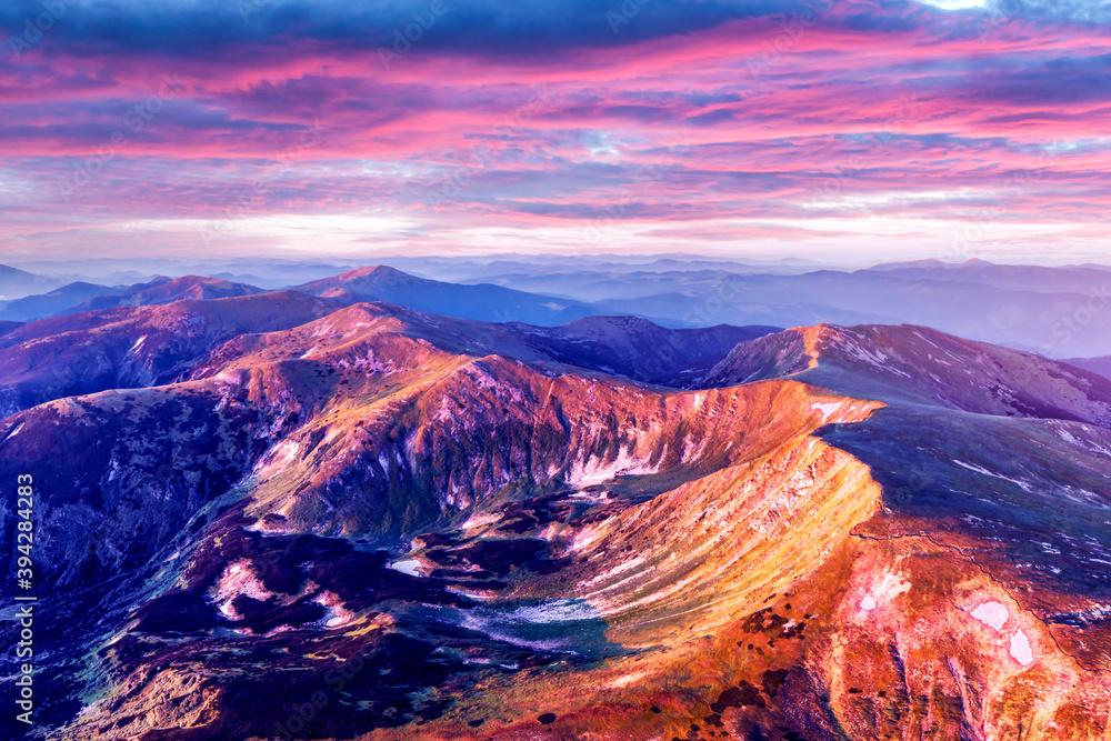 Fototapeta Hight mountains during purple sunset in spring season. Landscape photography