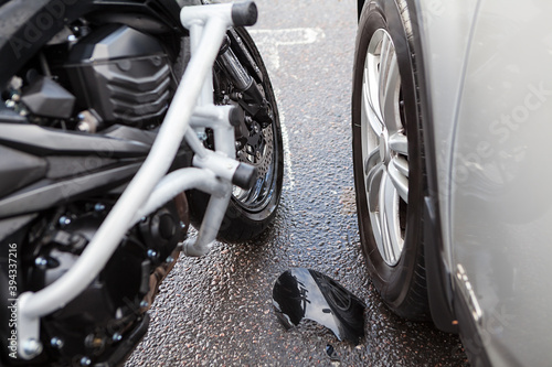 Canvas Print Motorcycle with engine bars hit a car at the road, postcrash investigation of ac