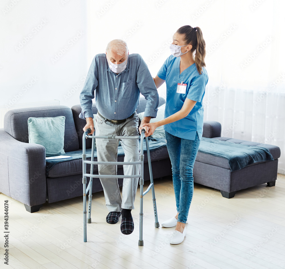 Fototapeta nurse doctor senior care caregiver help walker assistence retirement home nursing mask corona protection man