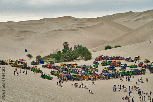 A lot of sand buggy standing in the high dunes at the oasis of Huacachina, Peru, Fotobehang