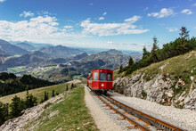 SCHAFBERGBAHN Cog Railway Running From St. Wolfgang Up The Schafberg, Austria.Journey To The Top Of Alps Through Lush Fields And Green Forests.Beautiful Mountain Panorama.View Of Lake Wolfgangsee