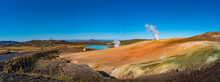 Panoramic View Over Geothermal Active Zones Near Myvatn Lake And Reykjahlid Small Town In Iceland, Resembling Martian Red Planet Landscape, At Summer And Blue Sky