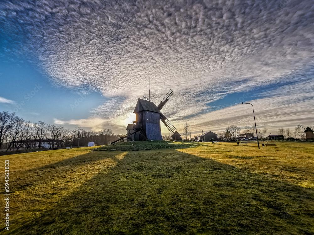 Fototapeta Windmill in the clouds
