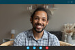 canvas print picture Computer application display head shot view smiling young african american man holding video call distant conversation with friend, looking at web camera or passing remote job interview at home.