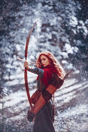 Stampa su Tela girl archer in a winter forest