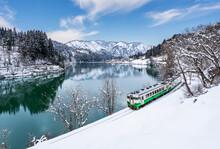Beautiful Landscape Of Tadami Line Train Across Tadami River In Winter At Fukushima, Japan
