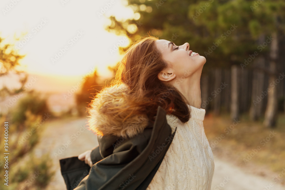 Fototapeta woman with closed eyes looking up fresh air freedom of travel