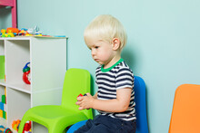 The Little Boy Abandoned By Everyone Is Sitting In The Playroom